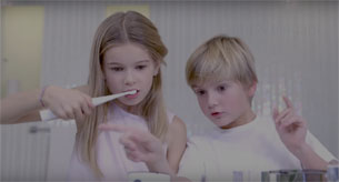 Two children using their smart electric toothbrushes