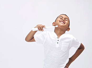 child brushing with interactive toothbrush